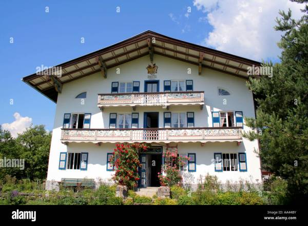 Traditional Bavarian Farm House With Wooden Carved Balcony