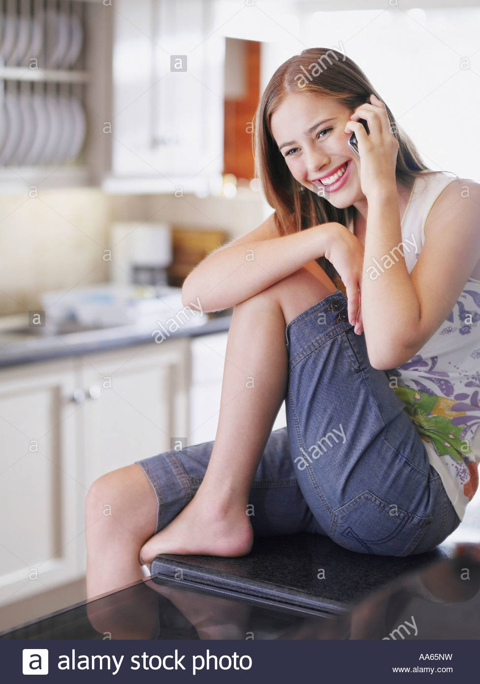 kitchen phone aid pasta attachments teenage girl talking on cell in stock photo 12527124