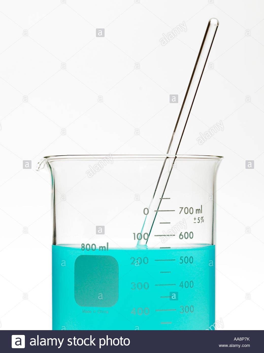 hight resolution of blue liquid in beaker with stirring rod