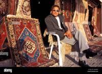 Portrait of a carpet seller in front of Sisko Osman carpet ...
