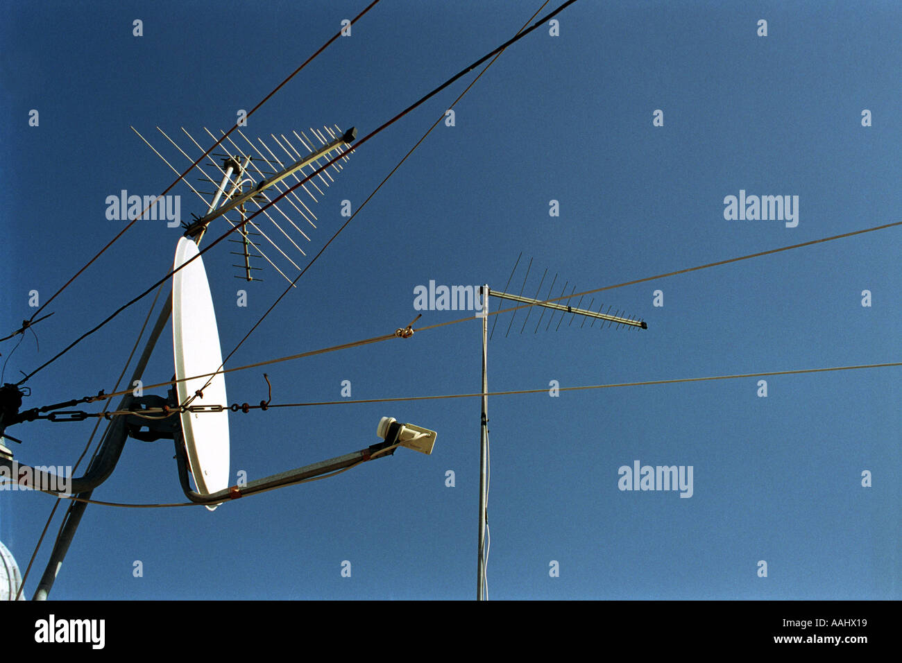 hight resolution of satellite dish receiver and aerials and cables and blue sky