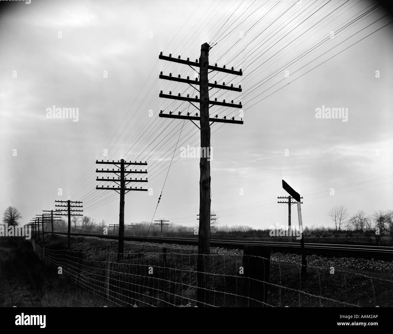 hight resolution of 1930s 1940s telegraph and telephone poles and wires along railroad track right of way stock