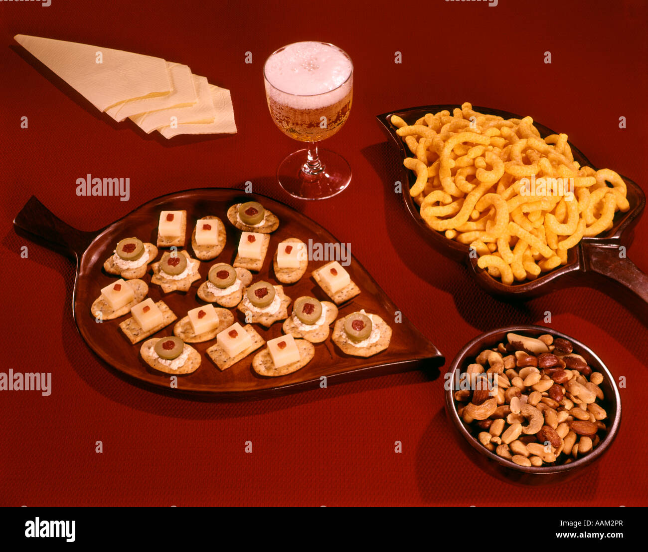 1950s 1960s canapes snacks glass of beer napkins stock image