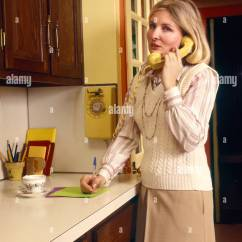 Kitchen Phone Knives Reviews Telephones 1970s Stock Photos Images Alamy 1970 Woman Housewife Talking On Yellow Wall In Note Pad Counter Writing