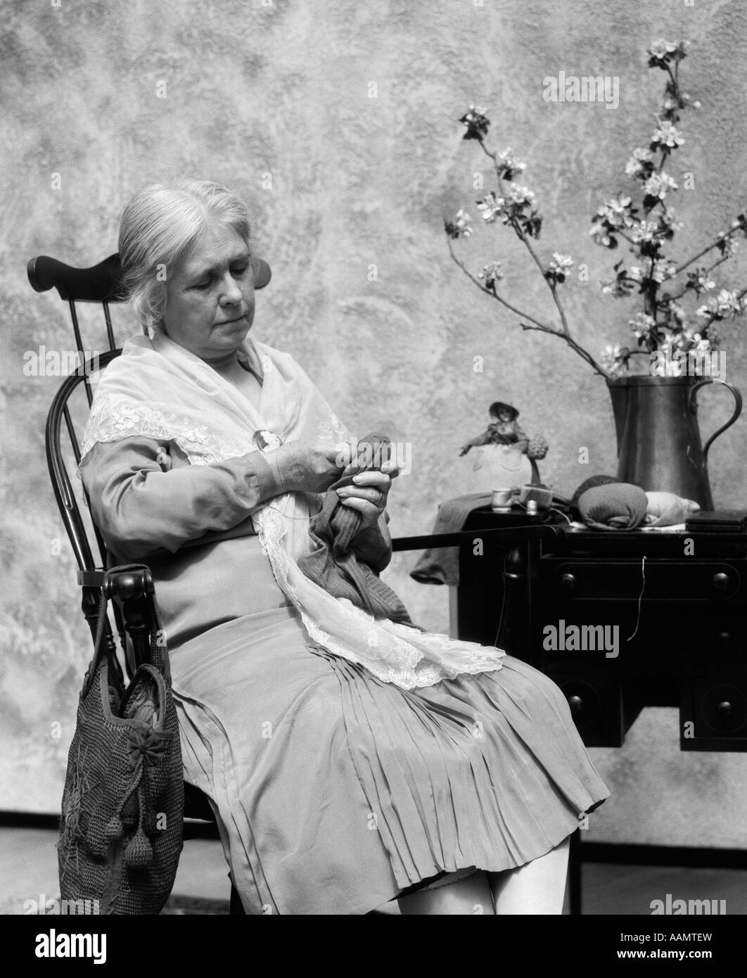 1920s rocking chair rustic tables and chairs for restaurants elderly woman sitting in darning sock stock