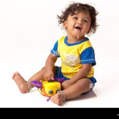 Baby Sitting Chair India Pb Desk Chairs South Asian Indian Ten Months Boy Playing With Toy