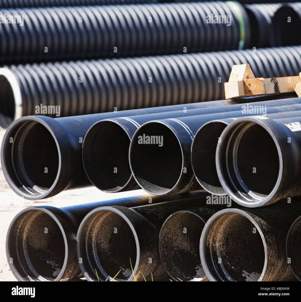 medium resolution of stacks of large pipes stock image