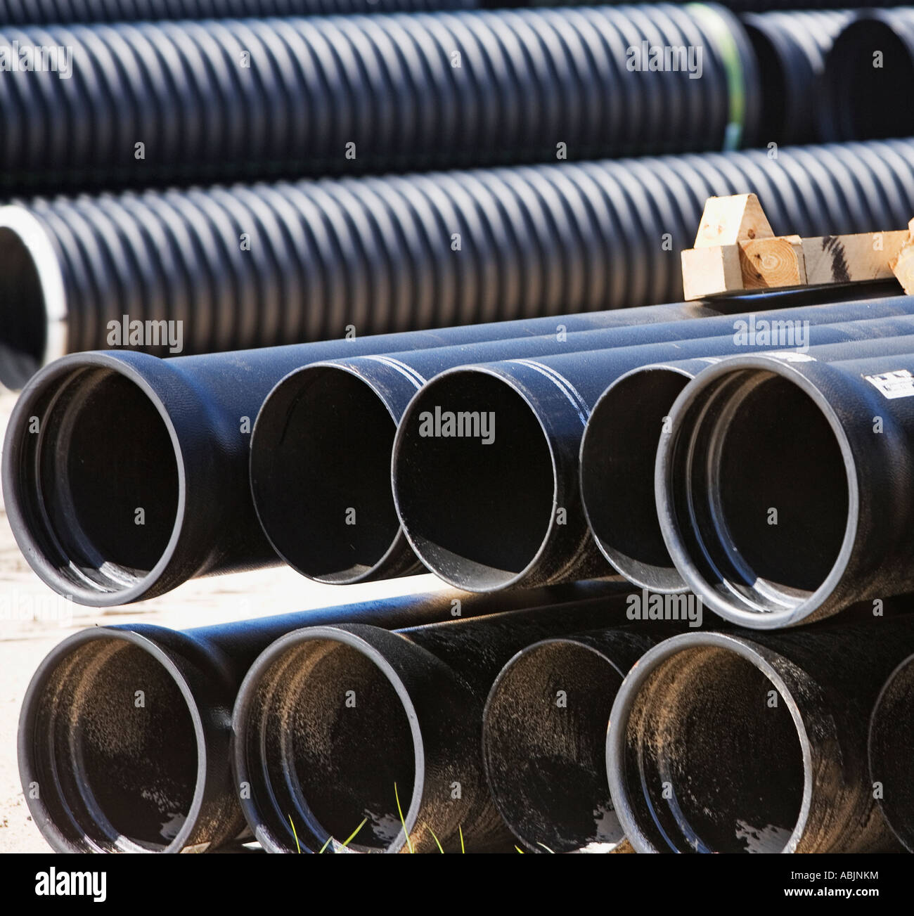 hight resolution of stacks of large pipes stock image