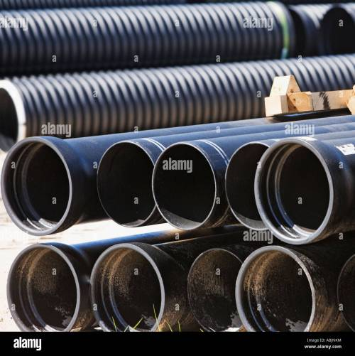 small resolution of stacks of large pipes stock image