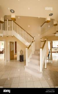 entrance hall of large modern home with balcony stairway ...