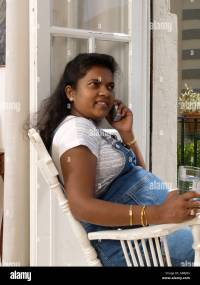 Indian Sri Lankan woman 8 months pregnant sitting in ...