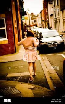 Barefoot Woman Walking On Street