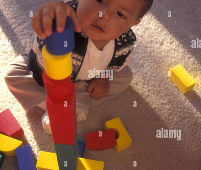 Toddler Boy Playing And Working Hard On Success With Balance Balancing Colorful Blocks Pov Mr Myrleen Pearson