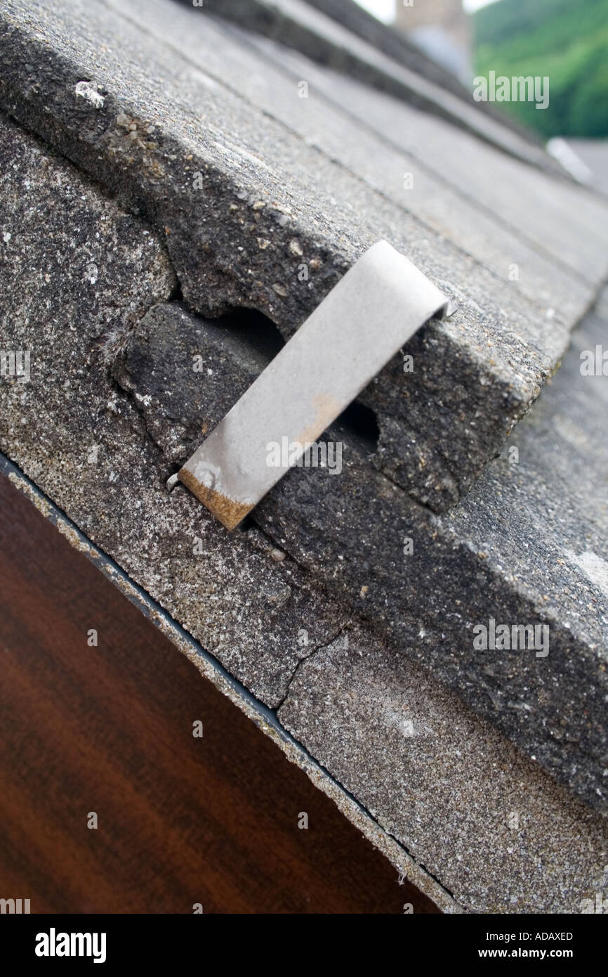 https www alamy com clip holding roof tile with cracked concrete mount wales uk image4362988 html