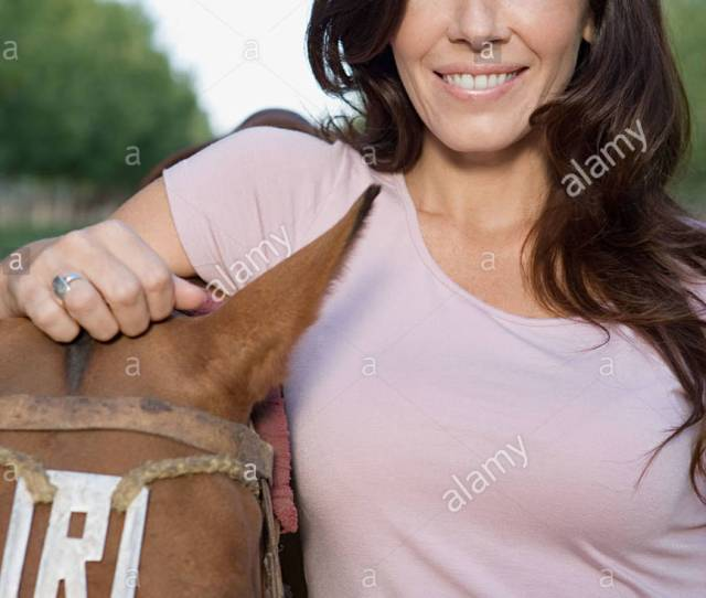 Smiling Woman With Horse Stock Image