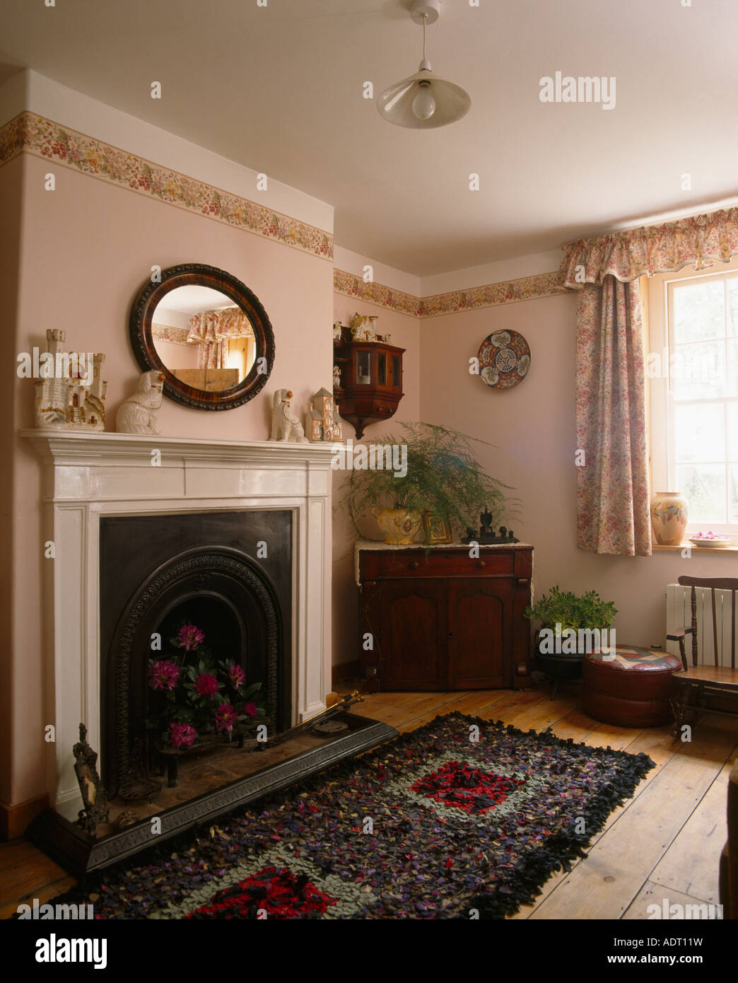 living room border light fixture ideas rag rug in front of fireplace small livingroom with wallpaper