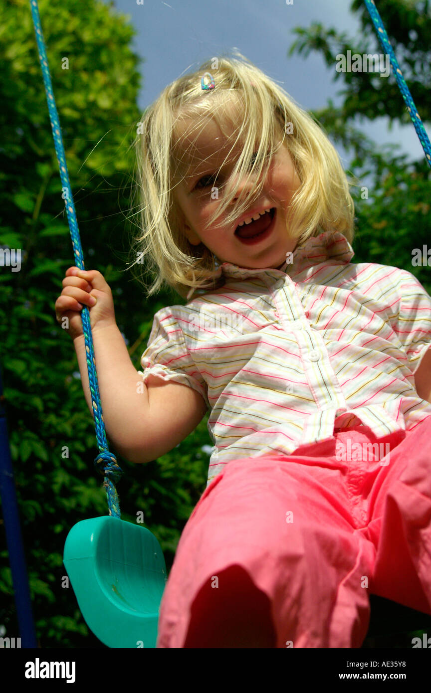 medium resolution of blonde girl sitting in a rope swing harness
