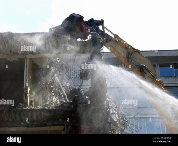 Crane Demolishing Building Stock &