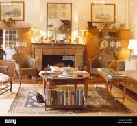 Lighted lamps on mantelpiece in French country living room ...