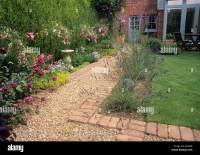 Path gravel brick small back garden design lawn house