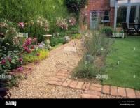 Path gravel brick small back garden design lawn house ...
