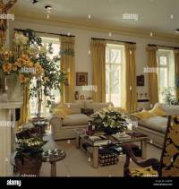 Yellow curtains French windows in traditional living room ...