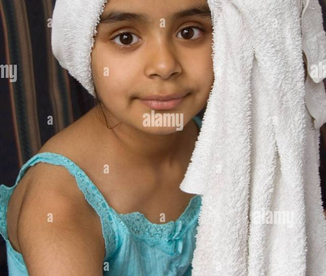 Young Indian Girl With Hair Wrapped In Towel
