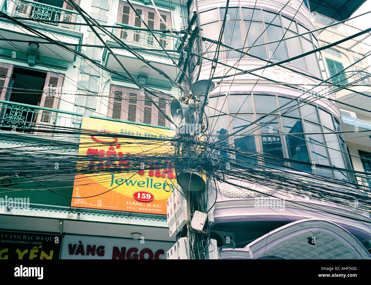 hight resolution of crazy telephone wiring in the old city of hanoi in vietnam in far east southeast asia telecom telecommunication street scene urban slum travel