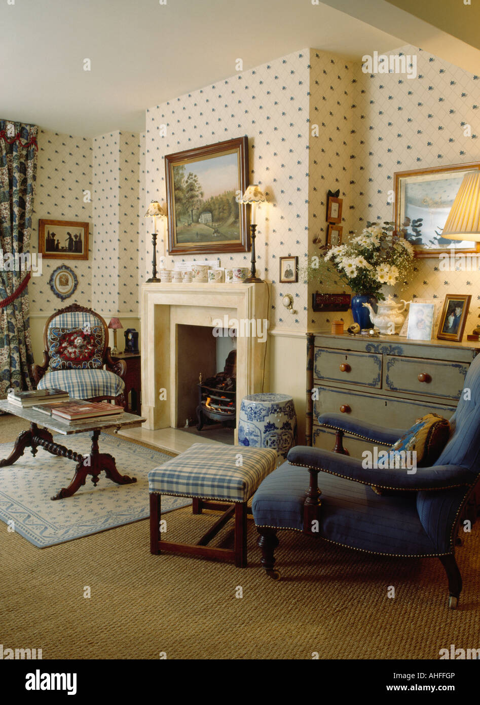 living room footstool interior design for with open kitchen blue armchair and checked in fireplace spotted wallpaper