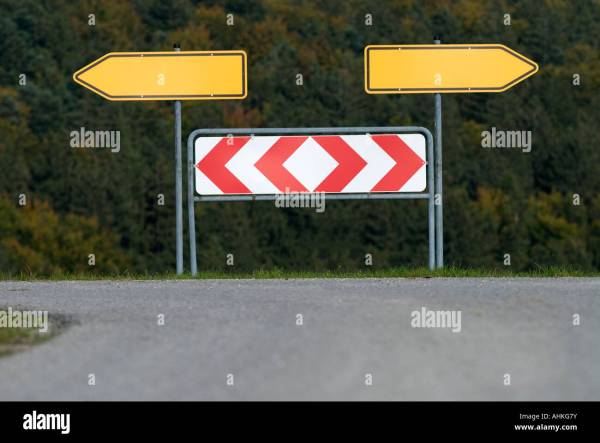 Traffic Sign Arrows Pointing Left And Germany Stock
