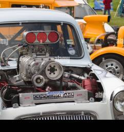 supercharged ford anglia popular drag car with v8 supercharged engine sticking out of bonnet [ 1300 x 956 Pixel ]