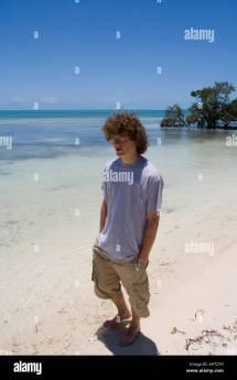 Teenage Boy Walking Barefoot Stock &