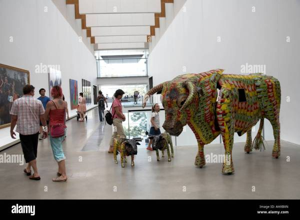 Bull Sculpture Display With People In Interior Of