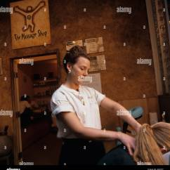 Chair Massage Seattle Game Amazon Usa Washington Greer Clark Rubs Customer S Back And Neck At The Shop In Capitol Hill Neighborhood