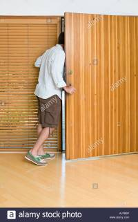 Man Opening Front Door Stock Photo, Royalty Free Image