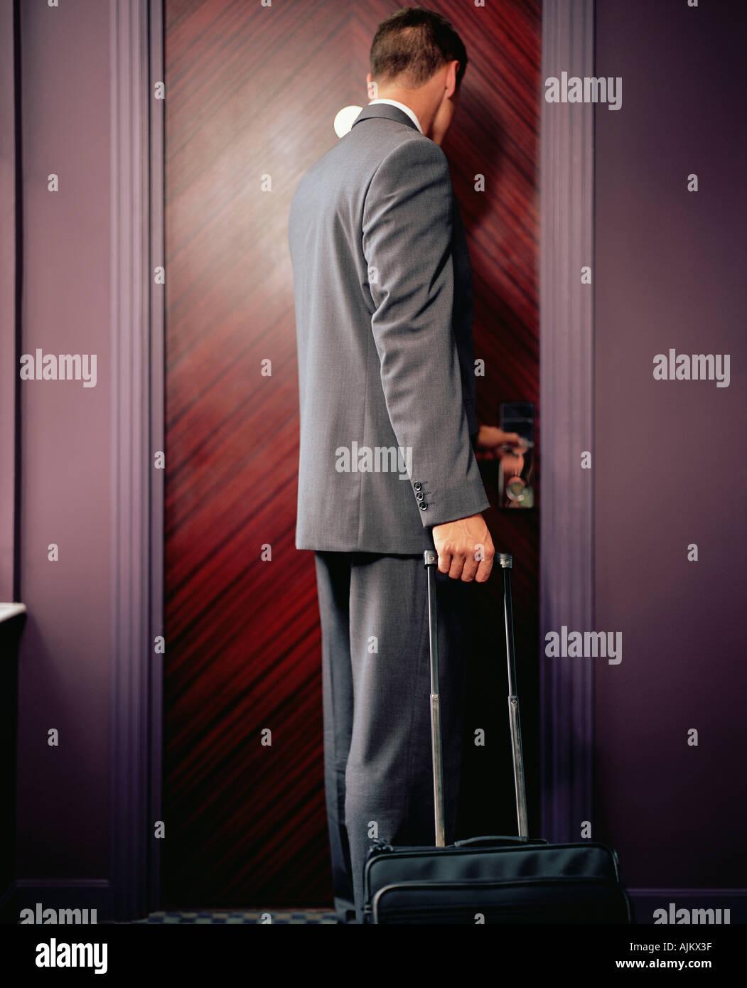 Man opening hotel room door Stock Photo, Royalty Free