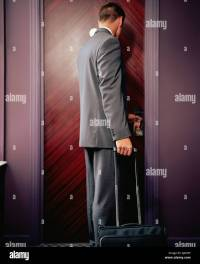 Man opening hotel room door Stock Photo, Royalty Free