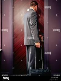 Man opening hotel room door Stock Photo, Royalty Free ...
