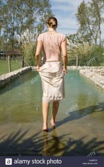 Barefoot Woman Walking Stock