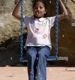 young indian girl in swing harness sitting outdoors [ 864 x 1390 Pixel ]