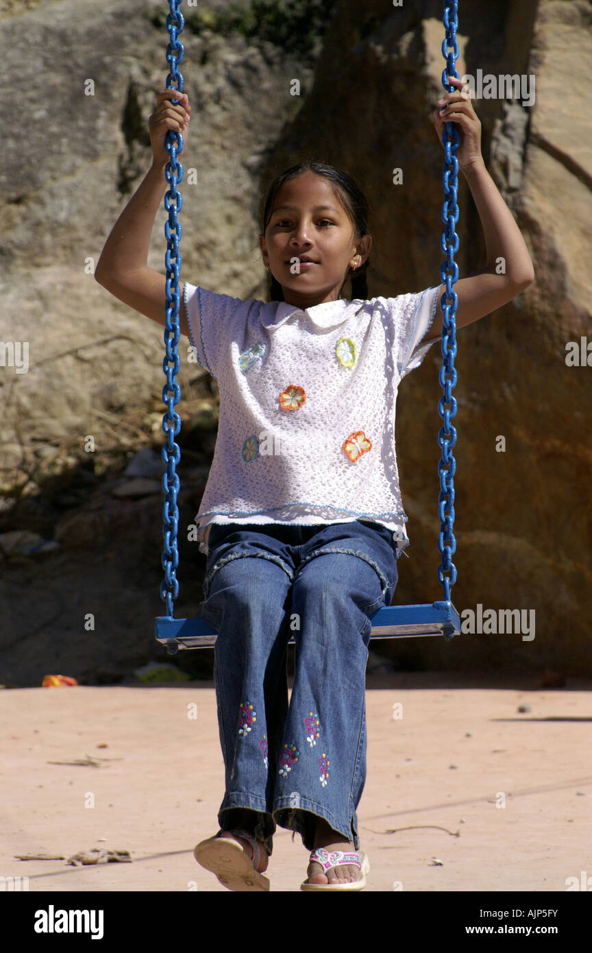hight resolution of young indian girl in swing harness sitting outdoors