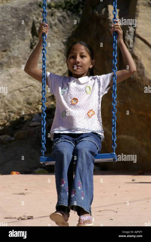 small resolution of young indian girl in swing harness sitting outdoors