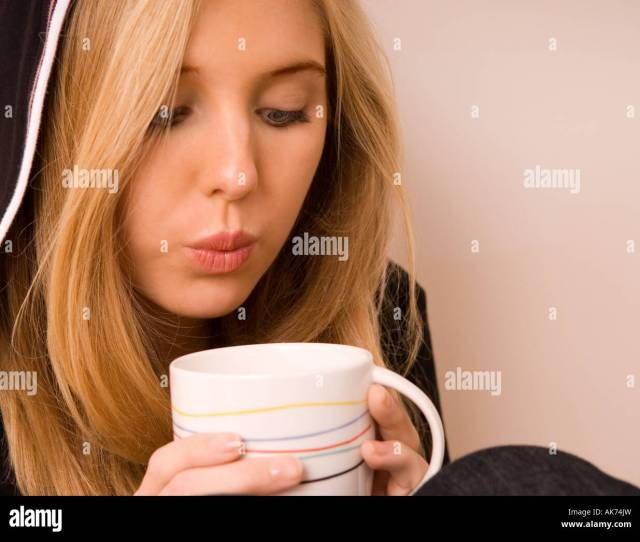 Caucasian Teen Girl 15 17 Blowing Hot Coffee To Cool It Usa