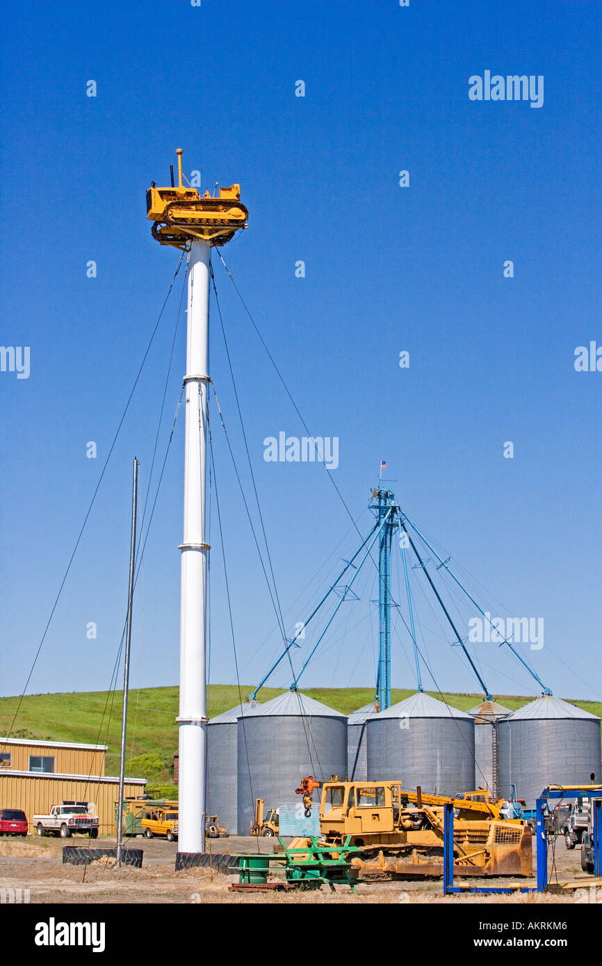 hight resolution of tractor sits on pole held in place by guy wires in the palouse eastern washington