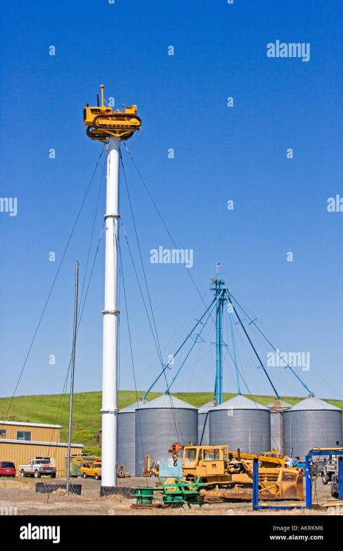 small resolution of tractor sits on pole held in place by guy wires in the palouse eastern washington