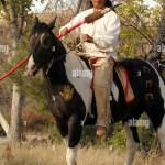 A Native American Indian Man Sitting On A War Painted Horse Portrait Stock Photo Alamy