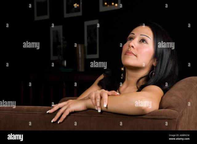 Mature Woman Sitting Looking Up Stock Image