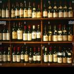 A Selection Of Bottles Of Wine On Wooden Shelves In A Paris