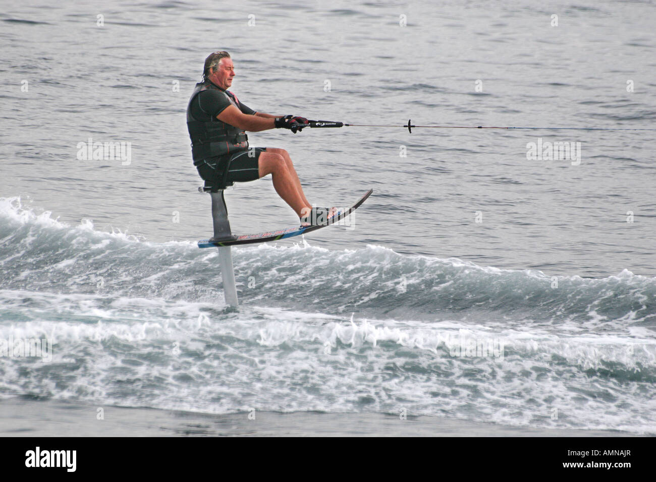 Water Ski Chair Man On Water Ski Chair Being Pulled At High Speed By Motor