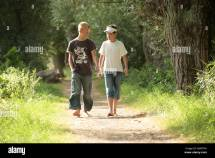 Two Boys Walking Barefoot Woods Stock